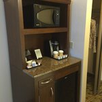 coffee bar, microwave, refrigerator unit.  Faux granite