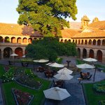 Courtyard of Hotel Monasterio with 330 year old cedar tree.