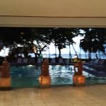 View from lobby overlooking pool and beach.