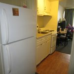Kitchen area, refrigerator/freezer, stove with oven, coffee maker, microwave oven, dishes, utens