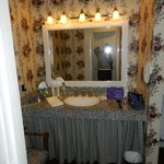 vanity in dressing area and closet