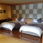 Beds in the western suite w private onsen