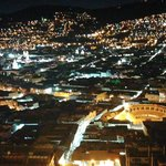 nite view of Quito from hilltop restaurant near hotel