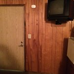 70's style wood paneling, a mismatched door and a tiny TV