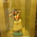 Hawaiian doll in elevator.
