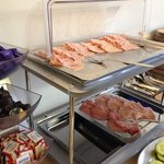 Cold meat section at breakfast bar.
