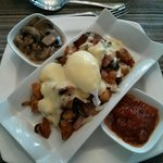 Breakfast poutine, caramelized tomatoes and mushroom ragout