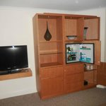 Nice new cupboard with minibar in room