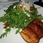 Blackened salmon with arugula salad.