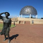 Waiting Woman in front of the seagull dome of the HMAS Sydney Memorial in Geraldton.