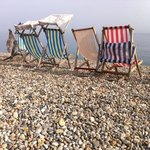 Deckchairs on the beach at Beer in the September sunshine