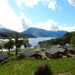 the cabins with Loch Leven beyond