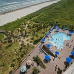 View from balcony of Unit 900 to pool and beach. Note the bridge over the dunes.