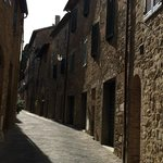 View of the street in front of Palazzo Capitano in San Quirico Val d'Orcia