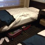 luggage has to be tugged below the bed