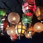 Lanterns and fixtures of all kinds hang throughout.