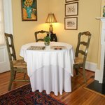 One of the several tables in the Dining Room