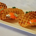Potato waffles with herbed cheese and salmon roe