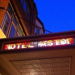 Astor sign lights up at sunset