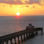sunrise beyond the fishing pier