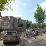 Parked cars and bikes along the Prinsengracht