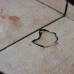 broken tile, private room, blood of the cuted foot