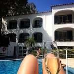 Champagne in the glorious sunshine by the pool surrounded by mountains!