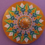 Traditional oxcart painted wheel in room