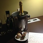 Complimentary champagne and chocolate-covered strawberries for our special occasion