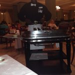 The server cutting my steak at the don Pablo restaurant