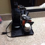 One serving cofee pot station in room.