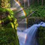 The sun strikes this waterfall just so, and a rainbow appears!