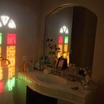 Bathroom, with morning light from stained-glass