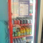Fridge stocked with soft drinks and beer