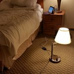 Hotel room fail. No outlets available near the bed.