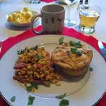 Breakfast delight: Egg frittata, roasted corn with ham, fresh pineapple
