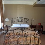 lovely iron wrought bed in suite