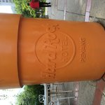 Giant flower pot with hotel logo