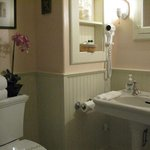 Large Private Baths Feature 6' Sanijet Jacuzzi Tubs, Pedestal Sinks & Heated Porcelain Floors