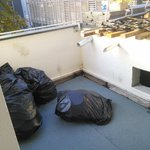 Balcony with rubbish bags