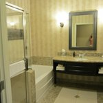Bathroom in Room at Oxford Suites Hotel