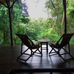 A pair of deck lounge chairs to sit and take in the sights and sounds of the jungle