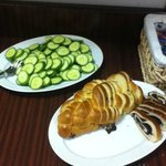 Breakfast - sliced cucumbers, poppy seed bread, cinnamon bread