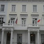 Melita House Hotel displaying the Maltese flag and the UK flag being the 50th anniversary of Mal