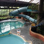 The pool area is complete with a water slide