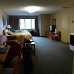 Large room with a desk and two double beds.  The beds were fantastic!