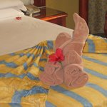 """a towel """"swan"""" on our bed"""