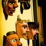 Masks, one of many historical art pieces displayed on the walls.