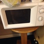 Microwave table?!? The microwave doesn't even fit.