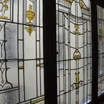 Leaded glass on the landings about the cage elevator